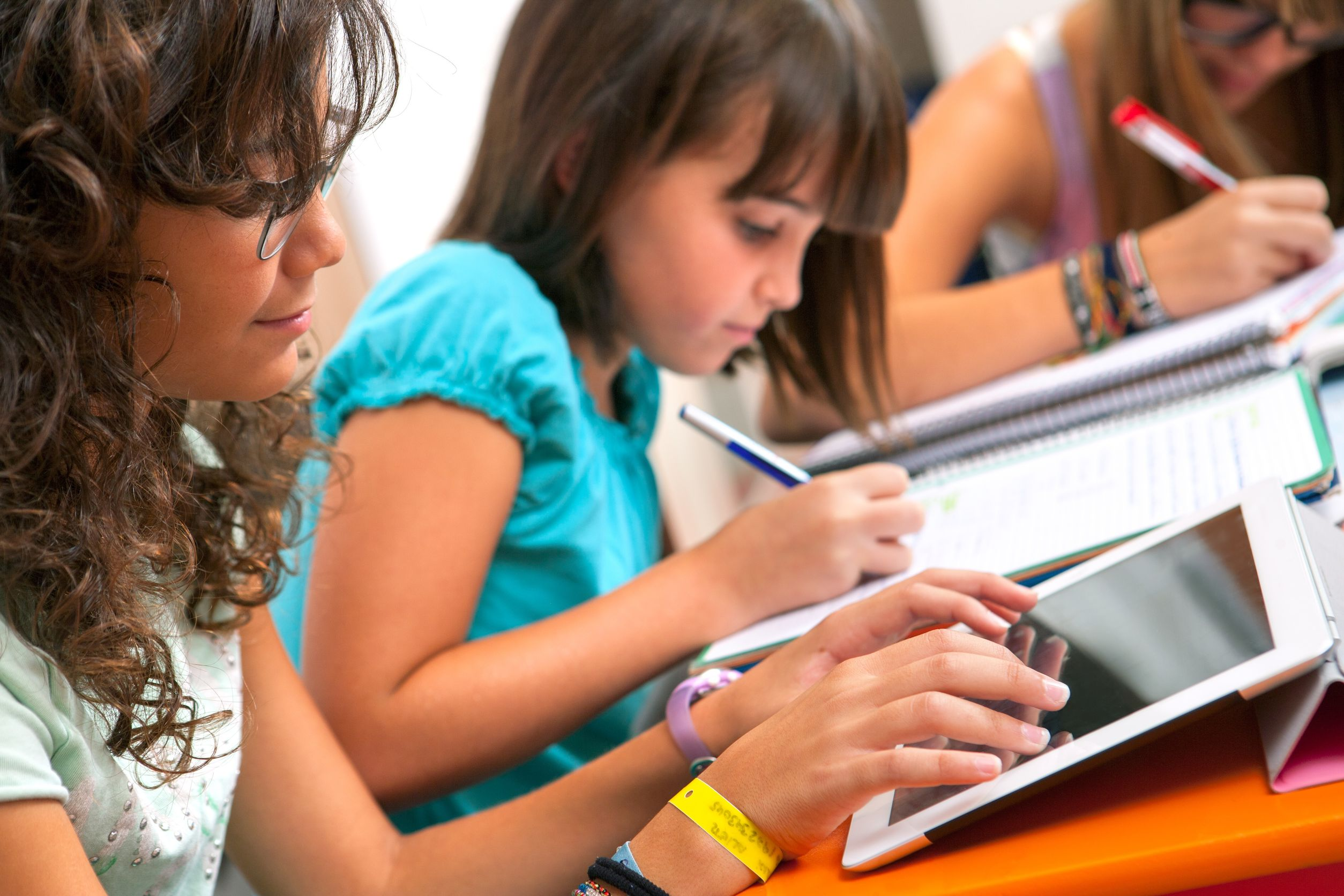 close up of teenage girls doing homework - AV in education