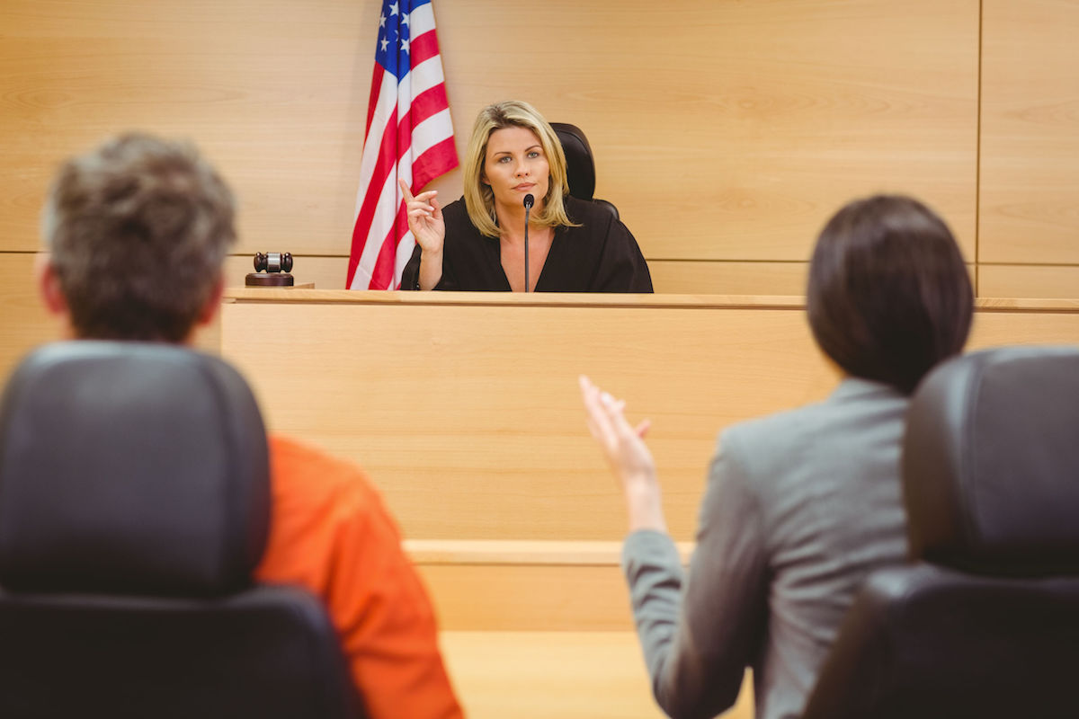 Judge and lawyer discussing the sentence for prisoner in the courtroom - courtroom AV